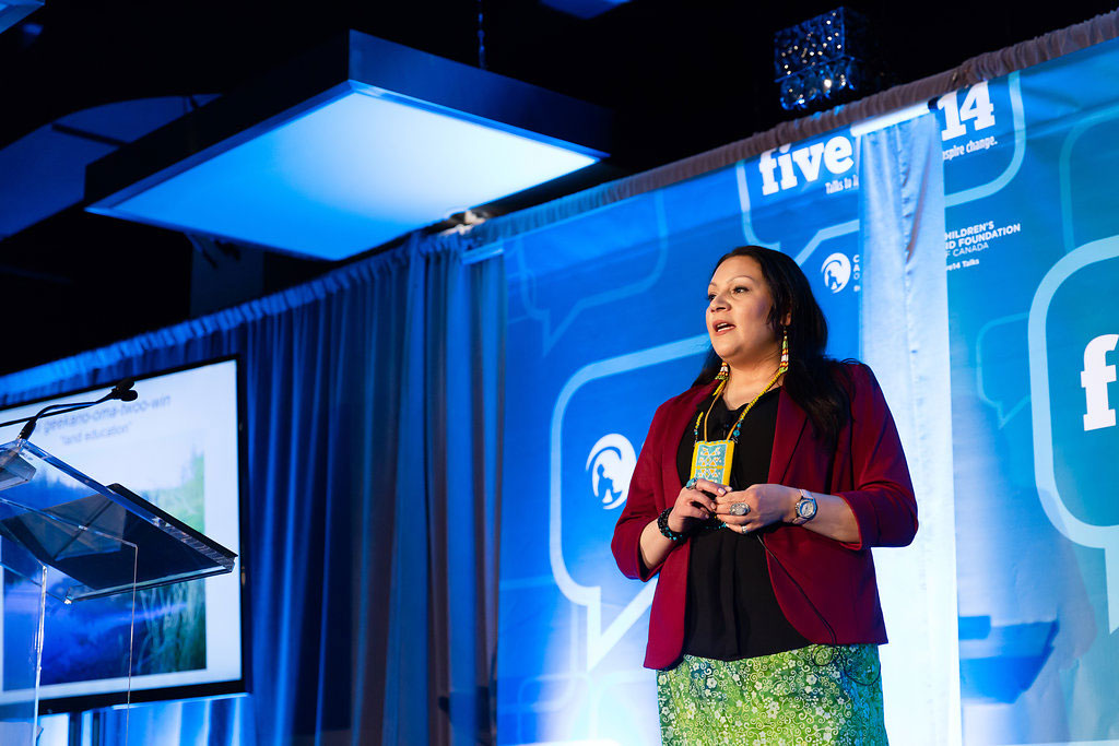 Chrissy Courchene on stage speaking at Five14