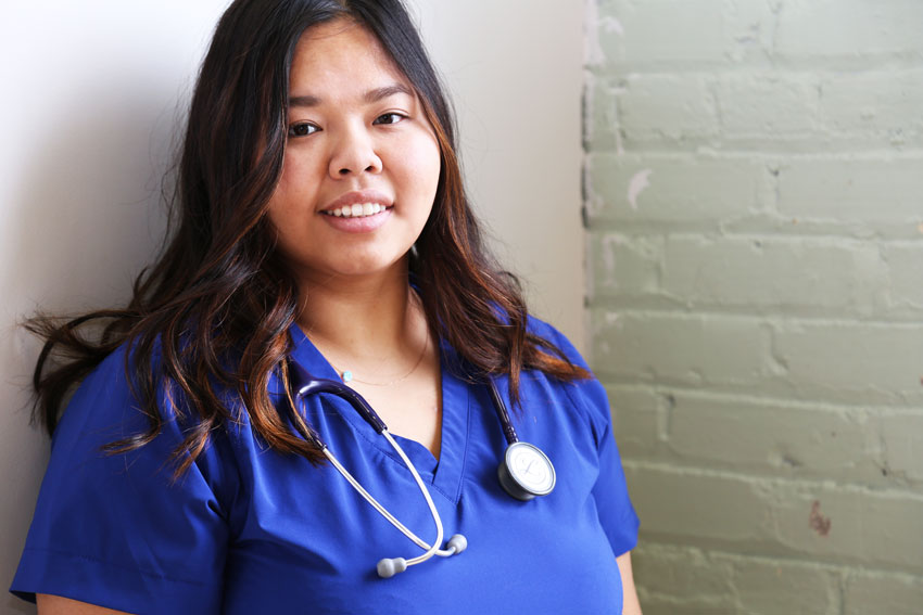 Youth wearing nursing scrubs and stethoscope