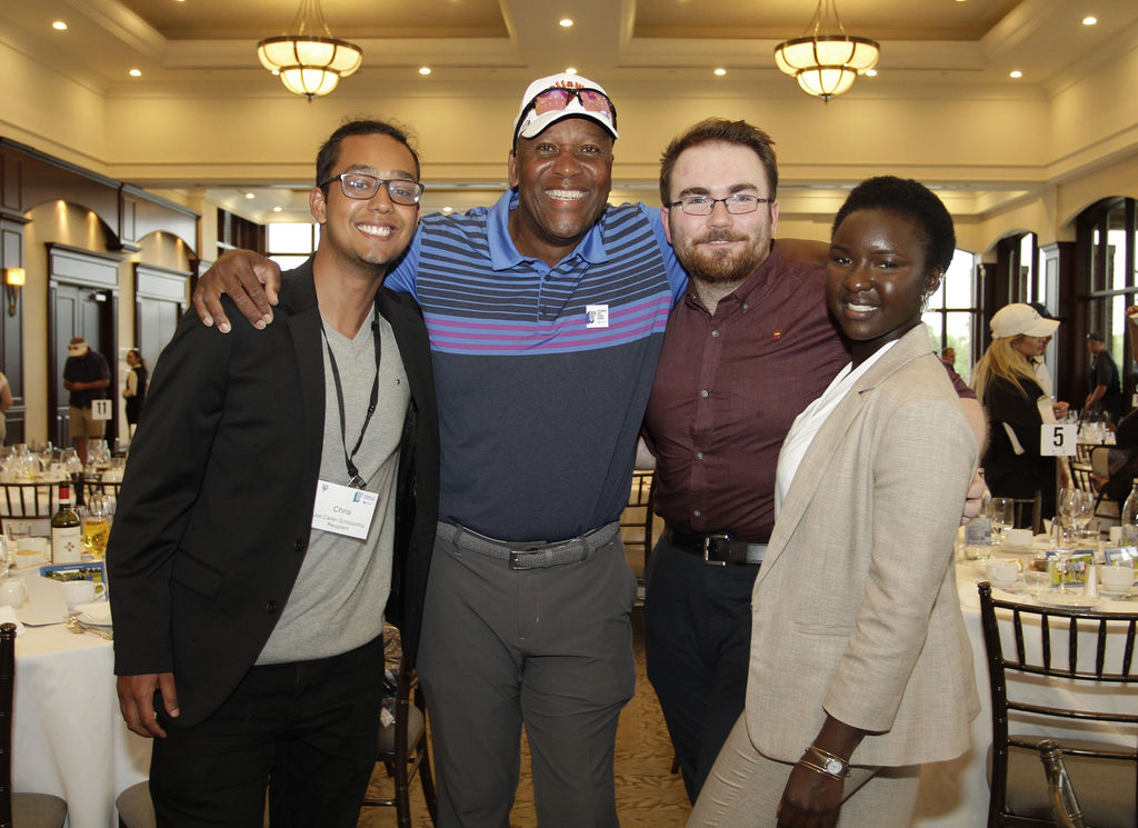 Joe Carter with three scholarship recipients 2019